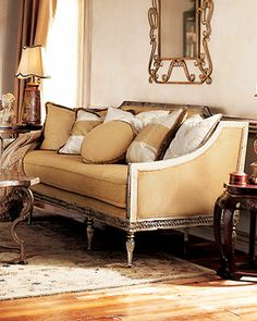 "Golden Settee by Vanguard at Horchow. Old-fashioned golden settee has a mahogany frame with an antiqued silver finish. Settee is upholstered in golden fabric of cotton, silk, polyester, and rayon. and includes assorted pillows as shown. Settee measures 82""L x 36""D x 39""H. Imported. $4,069.00 USD, Item# HCF13_H1VFW"