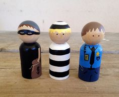KrisTeenyTinys Police set peg dolls a jail bird, a policeman and a robber! All painted with non toxic paints and a glossy finish. Wood Peg Dolls, Clothespin Dolls, Wood Toys, Spool Crafts, Craft Stick Crafts, Crafts For Kids, Wooden People, Wooden Pegs, Diy Toys
