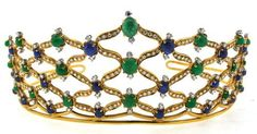 from 1970, a gold tiara set with diamonds, emeralds and sapphires