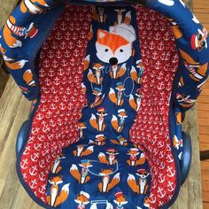 Robert Kaufman Fabulous Foxes fabric car seat cover. Fabric bought at www.thecraft-studio.com