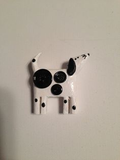 Hand Carved Dog Pin with button spots. by RockHillCarving on Etsy, $5.00