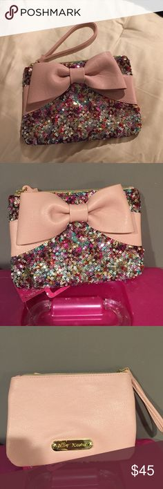 Betsey Johnson Clutch/ wristlet Betsey Johnson Clutch w multi colored Sequence and pale blush color leather, with Bow detail, never used no tags, width is 8 inches, length is 5 inches Betsey Johnson Bags Clutches & Wristlets