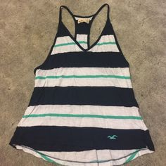 Tank top Racer back, v-neck tank top. It's very loose and comfy. Low cut on the sides, I wore it over my bathing suit at the beach Hollister Tops Tank Tops
