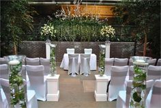 Barbican Centre Conservatory, next to The Garden Room. This is our favourite wedding ceremony set up. There is a glass ceiling, so it feels outdoors and there is a large birdcage with exotic birds creating a lovely audio backdrop.