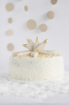 spice cake with speculoos cream, anise frosting & gilded cookie wings