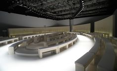 Catwalk tour: the top S/S 2014 women's fashion week venues / Salvatore Ferragamo: A dramatically lit oval catwalk flanked by all-white benches set the scene for Massimiliano Giornetti's minimal tailoring at Salvatore Ferragamo