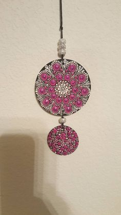 Great as a rear view mirror car charm! Hand painted mandala design. One side is vibrant pink, and it flips over to the other side- showing off the gorgeous blue side. Could also be used as a window decoration at your home or office.