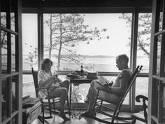 <strong>Caption from LIFE.</strong> On the porch, with boys off playing, the Fosters get some time to themselves. Bill Foster was down weekends and for a two-week vacation.