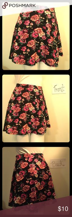 Floral Print Skirt This lovely floral print skirt is exactly what your wardrobe needs! Size M. Black background with pink and peach-colored flowers! 15.5 inches long. Charlotte Russe Skirts Mini