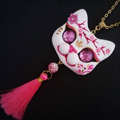 Gorgeous Hot Pink Kitsune inspired Cat necklace with sparkling eyes, Sakura flower crown and Nylon pink tassel. Hand sculpted with polymer clay; eyes made of glass and glitter; painted with acrylics , varnished and sealed. Metal settings, painted pink glass beads, ceramic white beads