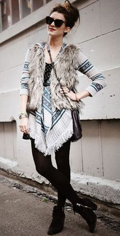 Fur vest, cardigan, skinnies, boots, and a top knot!