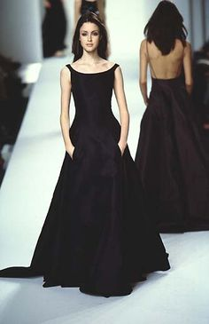 Black beauty. Fit and flare evening gown with a wide boatneck and thin straps, one of which is asymmetrically dropped. Two skirt pockets and small train. Style Planet | Ralph Lauren