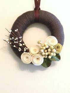 """Like the simplicity of the flowers. Not a fan of the plain round """"wreath"""" though. It would look cuter on a twig wreath."""