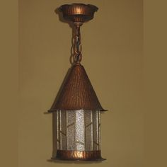 """All original pebble glass pieces intact. It must have been used indoors, since it came from Ohio, as the finish and patina look to be in their original condition. The hammered textured body of the shade and ceiling canopy was done to mimic the bark of a tree Has the whimsical character of a Hansel & Gretel cottage (""""storybook style""""). http://www.vintagelights.com/product/1/large-copper-storybook-porch-light-in-as-found-condition-with-original-finish-and-patina.html"""
