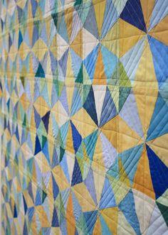 closeup of quilting, Kaleidoscope quilt by Ellen Luckett Baker at The Long Thread. Free download of templates.