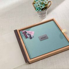 An album for keepsake. This innovative handcrafted album comes with a wooden case enclosed with a translucent front cover in acrylic. Crafted to perfection in premium leather as well as in premium quality cloth, this album is a perfect way to recreate the magic of your beautiful heartfelt memories