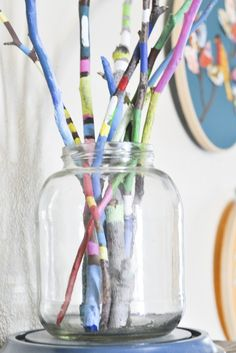 Painted Sticks in Glass Jar  this would be pretty with a white satin ribbon tied around the top of the jar.