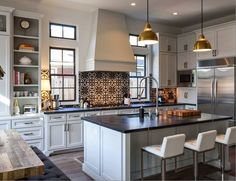 Dark countertops with light cabinetry mixes well with the graphic black and white cement tile Cement Tile Backsplash, Kitchen Tiles, New Kitchen, Cement Tiles, Kitchen Stove, Kitchen Shelves, Rustic Kitchen, Kitchen Decor, Dark Countertops