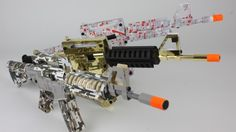 """The cardboard rifles are available in three iterations: """"Digital Ops,"""" """"Zombie Slayer,"""" an..."""