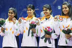 Photo - Day 8 action @ Asian Games  Anaka Alankamony, Joshna Chinappa, Aparajitha Balamurukan and Deepika Pallikal pose with their silver medals during the women's team squash award ceremony
