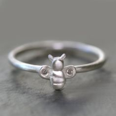 This reminds me of the little plastic bee rings I loved so much as a kid: Bee Ring in  Sterling Silver with Diamonds