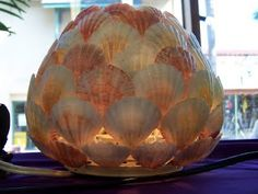 glass candle holder with seashells glued on?Annie's Seashell Ideas
