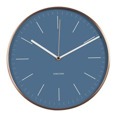 The classic Karlsson station-style wall clock Minimal with copper-plated steel case, copper second hand and blue dial is a rare piece of beautiful metalwork