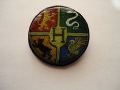 For Harry Potter fans - the brooch with the emblem of Hogwarts School of Witchcraft and Wizardry. Size - 5.5 cm in diameter