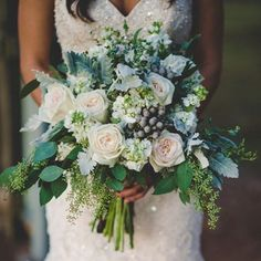 We have no words for this lush winter bouquet. {Photo: @cassiejonesphoto; Wedding Dress: @maggiesotterodesigns}