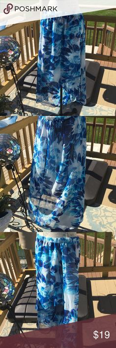 """Beautiful blue flowered skirt with a chiffon feel Faux wrap skirt (lined) with a hi/ lol hem. Beautiful many beautiful hues of blue. Very light and breezy!  Measurement when laid flat (all measurements are on unstretched garment) WAIST: 16 3/4""""  HIPS:25"""" LENGTH: front 23.5"""" back 35"""".  Never worn, just removed tags to wash Zac & Rachel Skirts High Low"""
