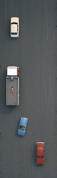 John Crawford has combined both nude and aerial photography for a compelling series titled 'Aerial Nudes'.