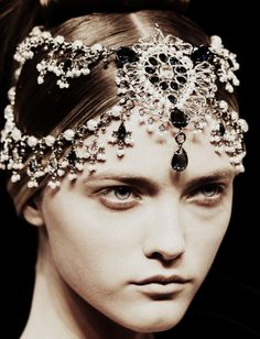 "Vlada Roslyakova for Alexander McQueen Autumn/Winter 2008  According to Vogue, McQueen was inspired by ""British colonialism, regal triumphs and his recent trip to India"". Many of the models were wearing headdresses similar to this one. This is a matha patti, a type of hair ornament/headdress from India worn along the hairline and the part in the hair.Images from here and here. ~~~jewelry for your head...so awesome!"