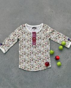 I don't particularly care for this exact shirt, but I could add that little Matilda Jane button strip to any shirt. Cute!