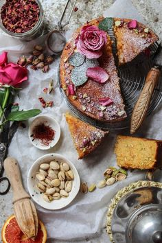 Persian Love Cake. Recipe: 1 c 250ml yogurt 1 tsp baking powder 6 eggs 1 c 220g sugar 1 1/4 c 150g ground almonds 1 c flour 150g or semolina 6 cardamom crushed 2 tbsp rosewater 6 tbsp chopped pistachios pinch saffron 100ml almond milk Lemon zest Bake 180c 350f 45 min (22cm 9 inch) pan Syrup: juice of 1 orange or lemon zest of 1 orange or lemon 1/2 c 125ml water 1/2 c 125g sugar 2 tbsp rosewater simmer until thickened brush onto warm cake Decorate