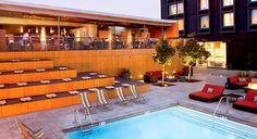 Custom Hotel: Los Angeles, CA. The pool features a multi-tiered sundeck, cabanas and a firepit