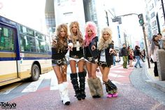 This photo features the Japanese street fashion style Gyaru. Gyaru style features tanned skin, bleach or dyed hair, and dramatic make up. Make up tends to consist of dark eyeliner and fake eyelashes used to make the eyes appear larger; make up is also used to contour the face to make it appear slim. The style is seen as a form of youthful rebellion or an encroachment of Western materialism on traditional Japanese culture.