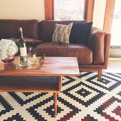 Love the carpet! Ready for some quality LP time. Things are getting weirdly romantic around here. Home Living Room, Apartment Living, Living Room Decor, Best Leather Sofa, Leather Sofas, Deco Retro, Brown Couch, Home And Deco, Living Room Inspiration