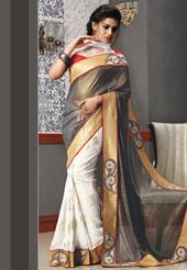 Complete your look for the upcoming party look by draping this grey and off white faux chiffon shimmer and faux georgette half- half saree designed with resham, zari, stone, applique and patch border work .
