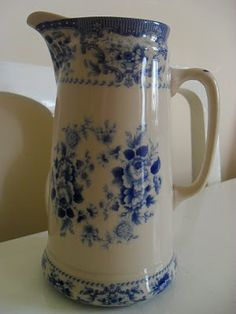I think this is the prettiest pitcher I have ever seen. The shape, design and color make it pretty!