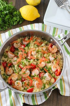 **Seared Shrimp and Summer Couscous** 3 Tablespoons olive oil 1 onion, chopped ½ jalapeño, minced 1 pint grape tomatoes, chopped in half 4 garlic cloves, divided 1½ cups couscous 2¼ cups chicken, seafood or vegetable broth, hot Juice of ½ a lemon 1 lb shrimp, de-veined and peeled (with tails still attached, optionally) 1 Tablespoons fresh parsley and green onions, minced and thinly sliced