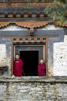 Two young monks at the former Royal Palace of Bhutan near the AmanKora Bumthang Hotel.   Ken Hayden Photography