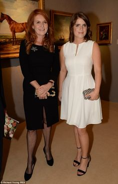 Art lovers: The pair looked suitably stylish as they attended the art auction gala, which they promoted on the website prior to the event.