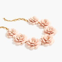 """We brought back one of our most popular necklace styles just in time for the holidays... These big blooms with crystal centers will perfectly polish off any outfit. <ul><li>Length: 20 1/2"""" with a 2 1/4"""" extender chain for adjustable length.</li><li>Brass, zinc, acrylic bead, glass stone.</li><li>Light gold ox plating.</li><li>Import.</li></ul>"""