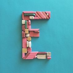 E is for Eraser. Letter e made out of erasers. This crafted letter is a part of the Kolbo Alphabet Challenge.