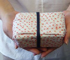 hand wrapped gift in fabric - Furoshiki, Japanese wrapping cloth
