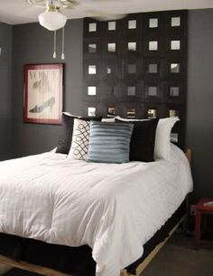 Masculine and edgy, yet clean.  DIY Ikea Mirror Headboard