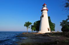 Marblehead Lighthouse on Lake Erie near Marblehead, Ohio. It is the oldest lighthouse in continuous operation on the United States side of the Great Lakes. (Circa 1822)