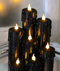 20 Spooktacular DIY Halloween Decorations: Faux Black Candles #HalloweenDecorations #ShermanFinancialGroup