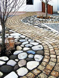 Enhance the look and feel of your yard by installing a stone walkway utilizing a mini-skid from Compact Power Equipment Rental.
