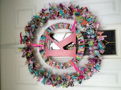 Made this wreath for our front door.  It is a tag wreath on the outside & flat wooden circle in the inside with the same scraps if fabric glued to it. Not really sure how I came up with the design, saw the rag wreath in a pin & then just added.